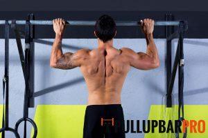 man-exercising-on-black-wall-mounted-pull-up-bar-pro-singapore